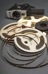 Still life of 8mm cine film reels and old movie camera.