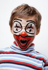 little cute boy with facepaint like clown, pantomimic
