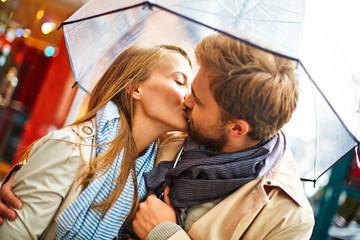 Kissing under umbrella