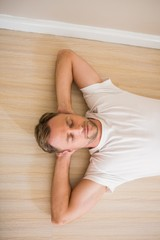 Happy man lying on floor