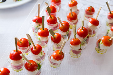 Caprese salad. Skewers with tomato and mozzarella with basil.