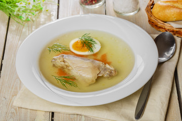 chicken broth with meat and boiled egg