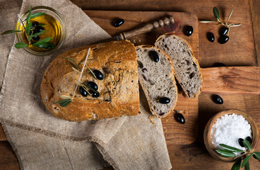 Wall Mural - Sliced homemade olive bread, top view