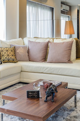 white sofa with pillows and wooden table in living room
