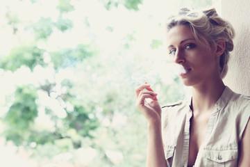 beautiful girl smokes