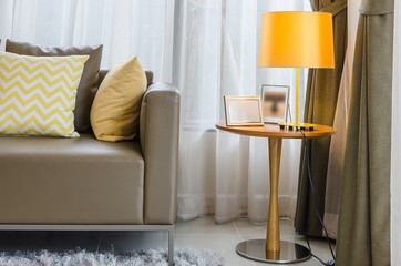 modern living room with yellow lamp