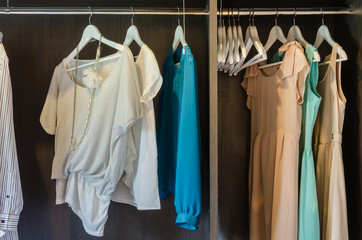 dress hang in wooden wardrobe
