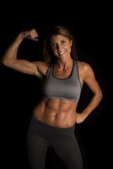 woman gray sports bra on black flex one arm
