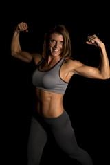 woman gray sports bra on black flex