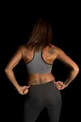 woman gray sports bra on black hands on hips
