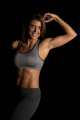 woman gray sports bra on black one arm up look