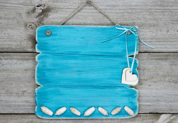 Blank blue sign with hearts and seashells