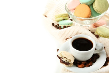 Gentle colorful macaroons in glass bowl and black coffee in mug