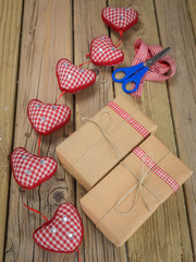 string and brown paper parcels with scissors, ribbon  and hearts