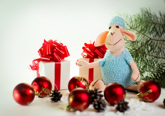 toy lamb with Christmas balls and fir paws gifts