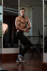 Young Man Performing Side Chest Pose