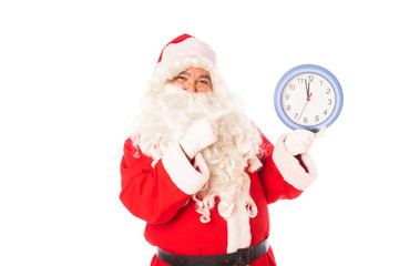 santa claus with a real clock in hands showing almost midnight,