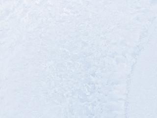 Frosty pattern on winter window.
