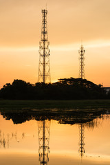 Silhouette telecommunications towers on sunrise