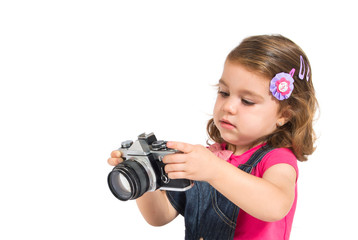 Kid photographing over white background