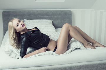 provocative female posing on bed
