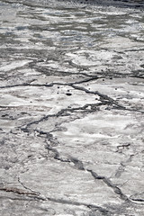 Background shot of a dry saline creating a crust of salt.