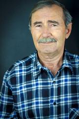 Portrait of senior man with mustache