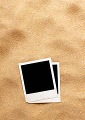 Old style empty photo cards lying on a sea sand