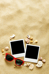 Instant photo frames on the beach with seashells around
