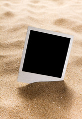 Old style empty photo cards on a sea sand