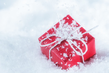 Red gift box in snowflakes