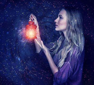 Beautiful woman with magic lantern