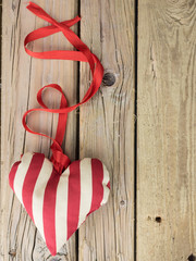 textile heart with red ribbon