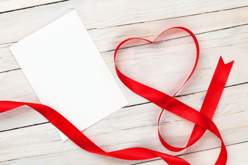 Valentines day heart shaped red ribbon and blank greeting card