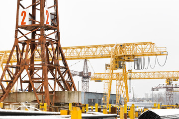 tower and gantry cranes in metal product warehouse