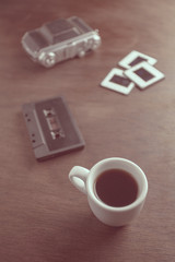 Old camera and coffee cup