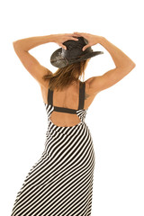 woman in striped dress cowgirl hat back