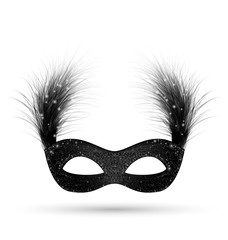 Black carnival mask with fluffy feathers isolated on white backg