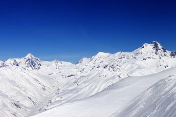 Snowy mountain peaks in sun nice day