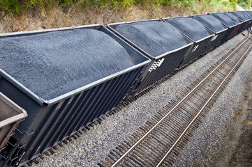 Line of Coal Freight Cars On Train Track