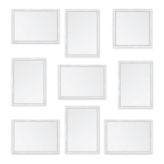 Set of white wooden frames isolated on white background