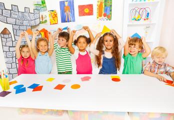 Happy boys and girls in the kindergarten art class