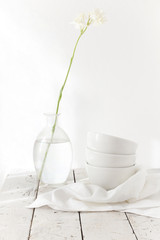 total white table with stem tuberose flower on glass and bowls