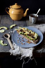 wholemeal vegan toast with avocado slices and black sesame seeds