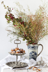 coconut sweets on dessert stand with wild flowers bouquet