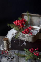 vintage boxes for Christmas gifts with berries and pine twigs