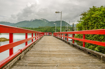 Wooden Jetty and Cloudy Sky