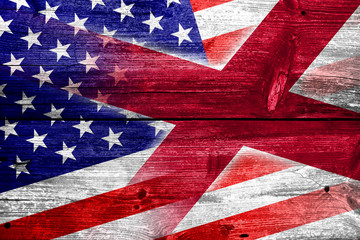USA and Alabama State Flag painted on old wood plank texture