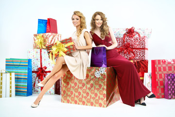 Two adorable women with plenty of Christmas gifts