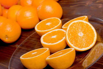 sliced ripe appetizing delicious orange on brown table